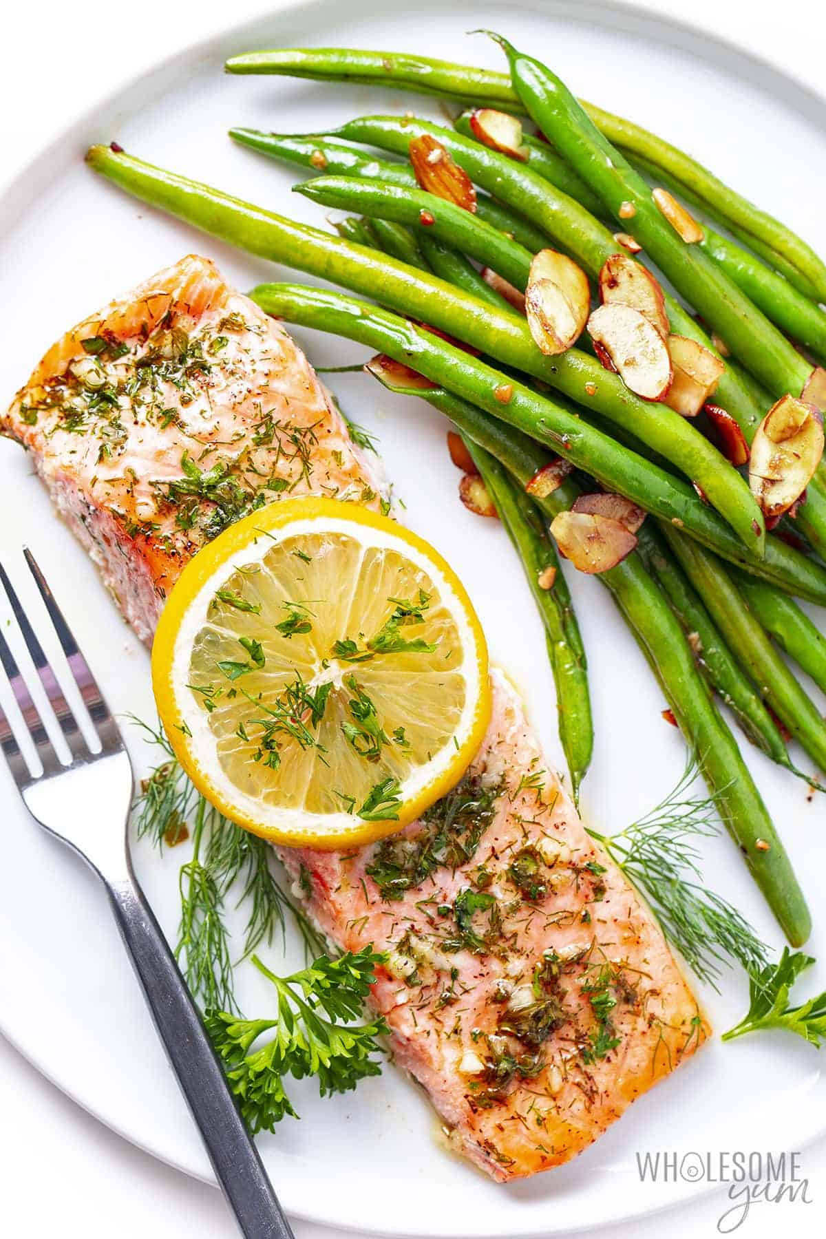 Easy baked salmon on a plate with green beans