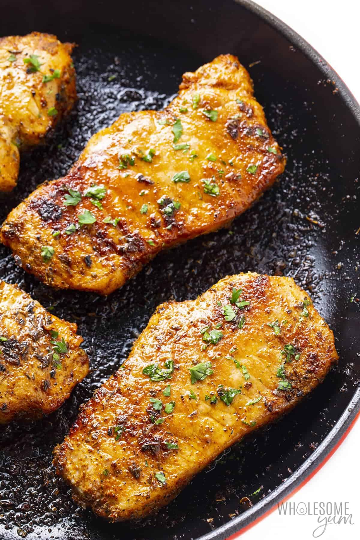Pan seared pork chops in a cast iron skillet