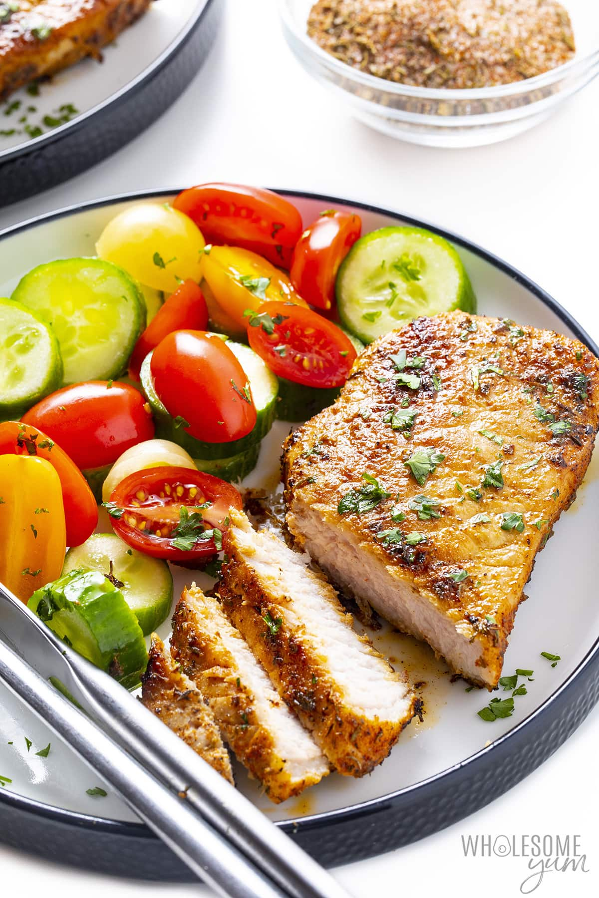 Pork chop with pork chop seasoning and veggies