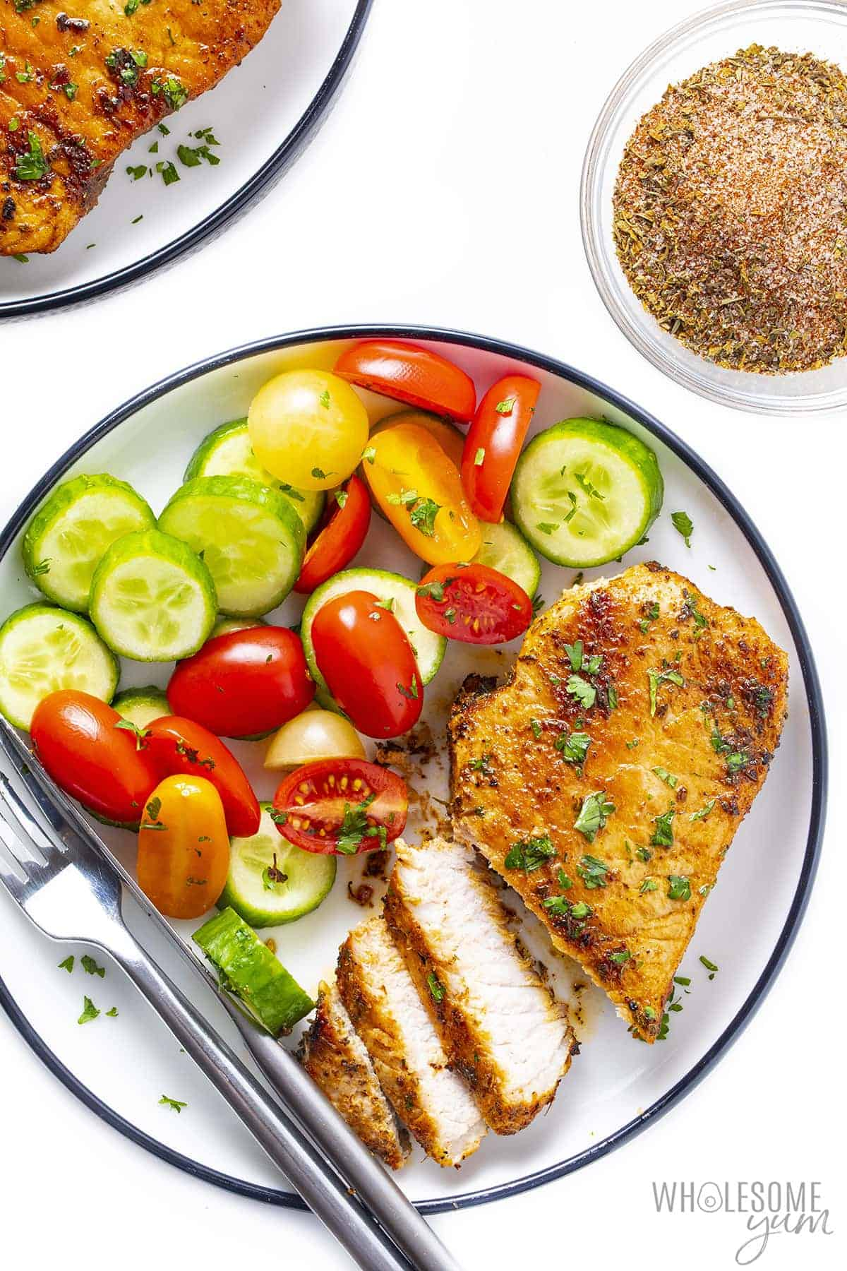 Plate with skillet pork chops and vegetables