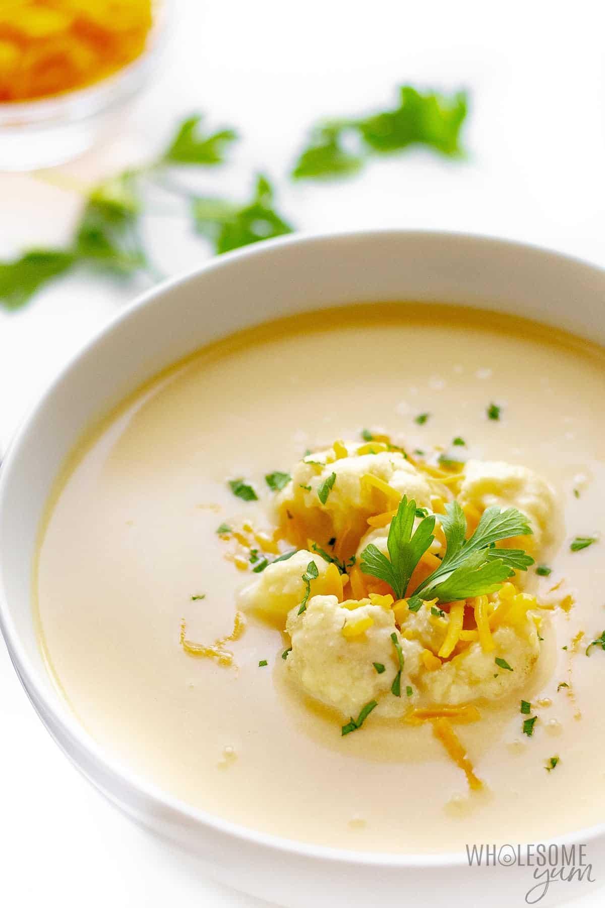 Bowl of cauliflower cheddar soup