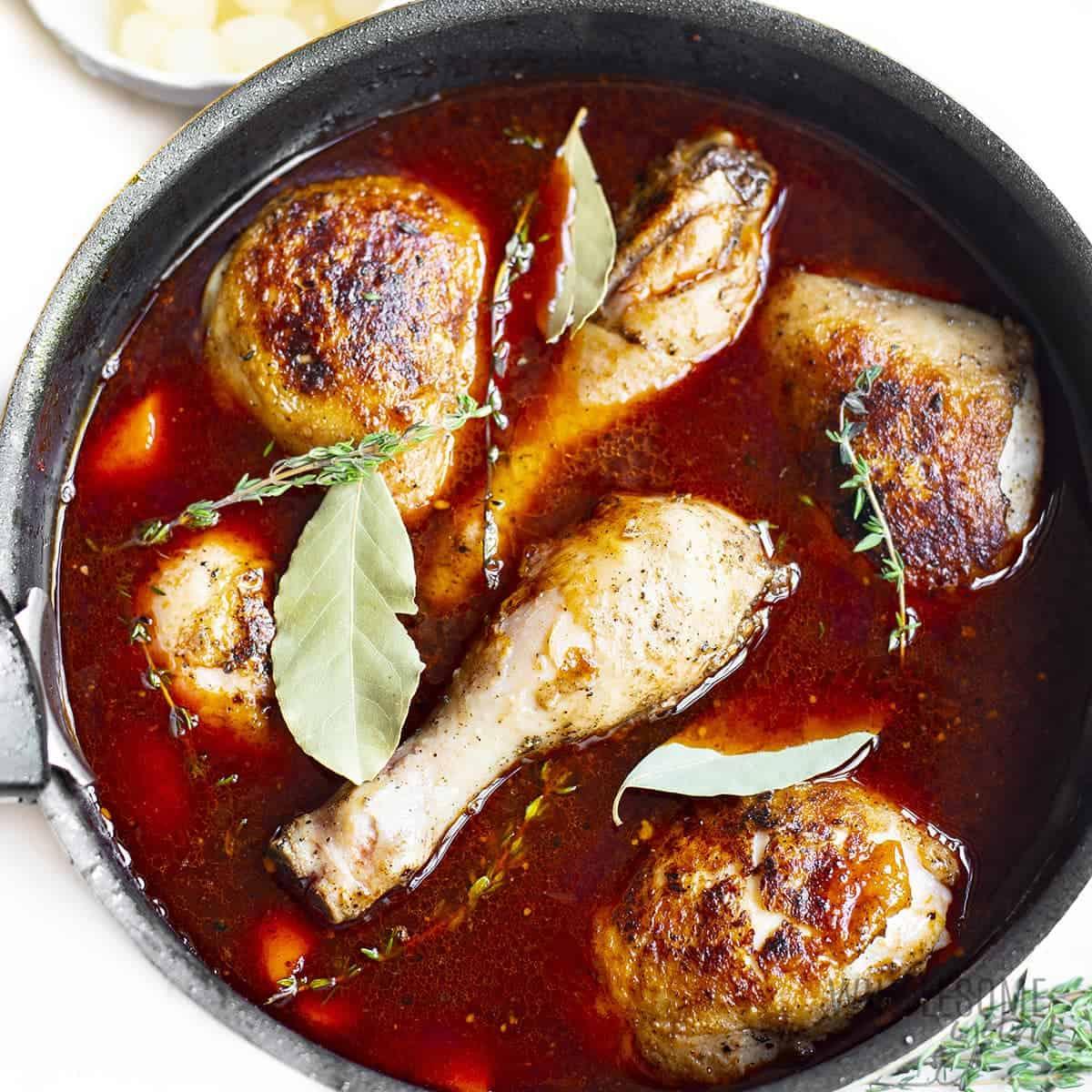 Chicken coq au vin simmering