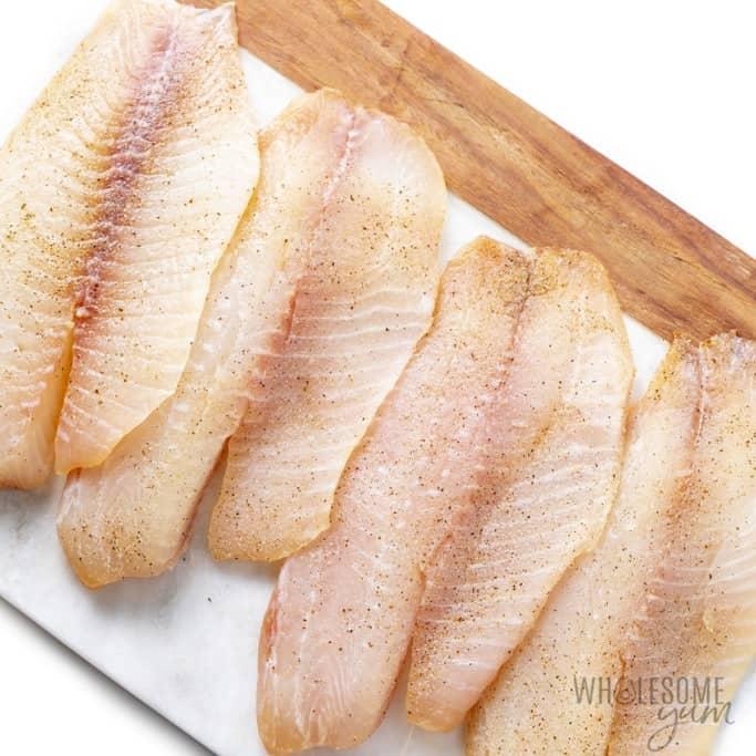 Seasoned raw tilapia fillets