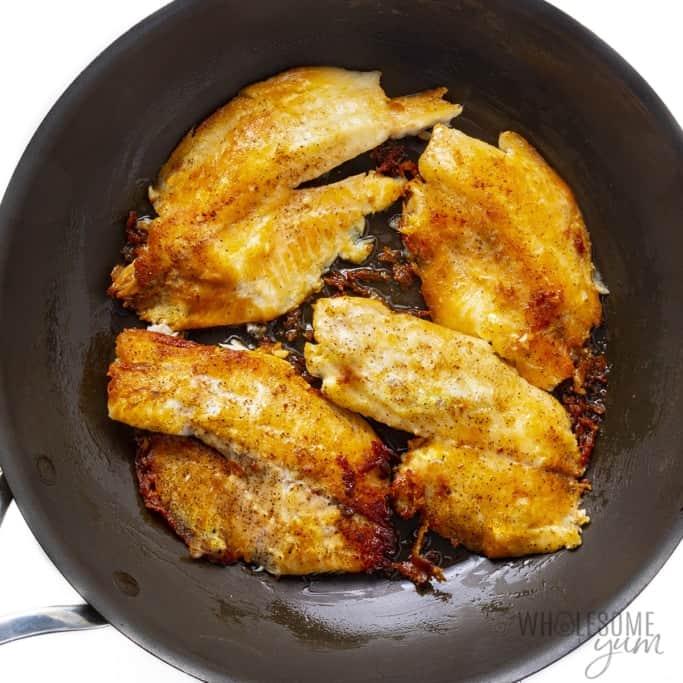 Tilapia fillets fried in a pan