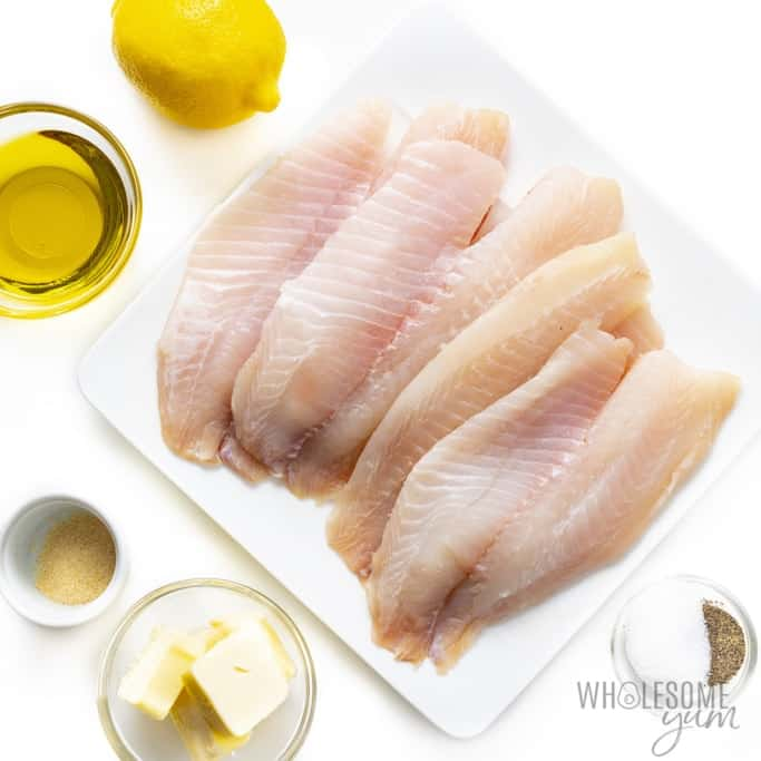 Pan seared tilapia with lemon butter sauce ingredients on plates