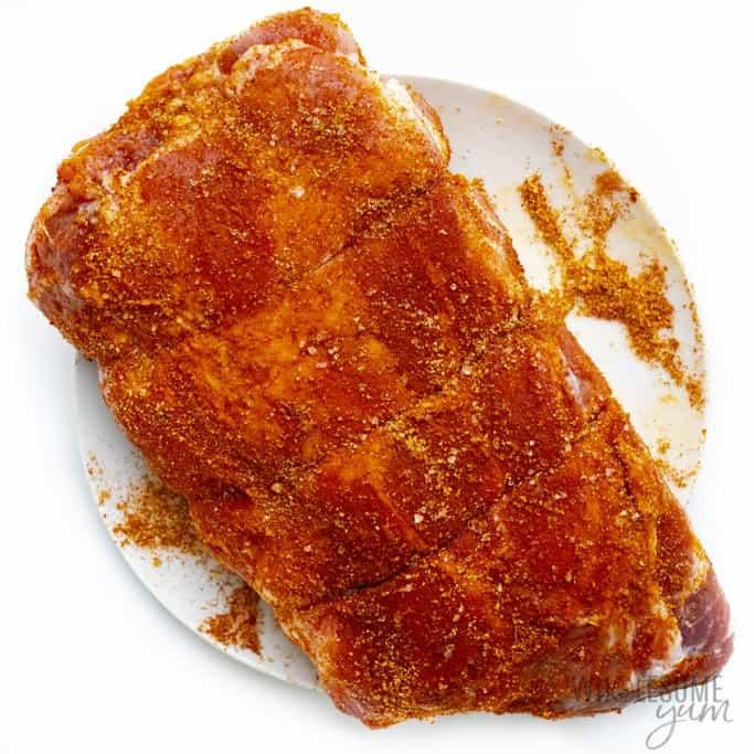 Raw pork shoulder with pulled pork seasoning