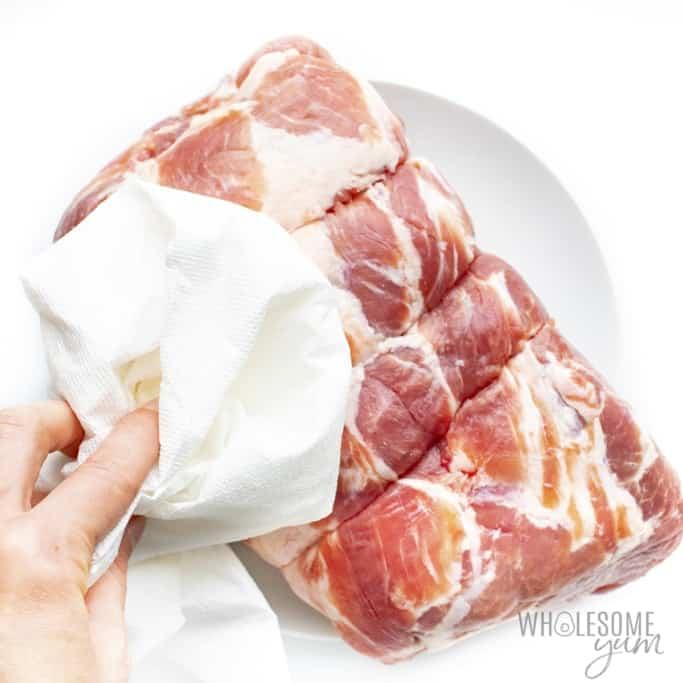 Patting pork dry