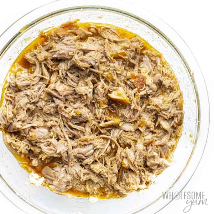 Shredded pork with pan juices in a bowl